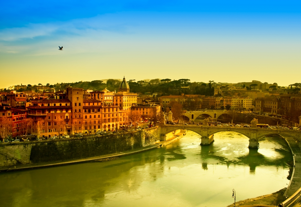 View of Rome and Tiber river at dusk.